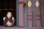 Asian Woman At Temple Window