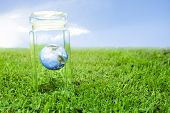 Protecting Earth Inside A Crystal Jar Over Grass, Ideal For Background.
