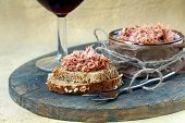 stock photo of canard  - pate of duck meat Rillettes de Canard  with a glass of wine - JPG