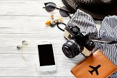 Hello Summer Holiday Concept. Stylish Swimsuit, Hat Sunglasses And Shells Passport Phone Photo Camer poster