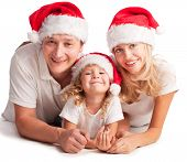 stock photo of christmas hat  - Happiness family in christmas hat isolated on white - JPG