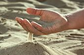 Sand flowing through your fingers