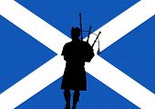 stock photo of bagpiper  - silhouette of a man playing the bagpipes over a flag of Scotland - JPG