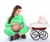 Pregnant Woman Sitting Next To A Carriage