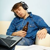 Man Fell Asleep At Home On Couch With A Beer
