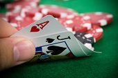image of poker hand  - Ace of hearts and black jack with red poker chips in the background - JPG