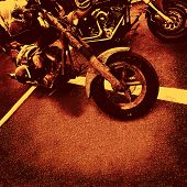 motorbikes in orange brown sienna color on asphalt to use as background or cd cover