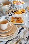 stock photo of tea party  - table set for high tea with sweet cookies - JPG