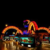 image of amusement park rides  - colorful lit octopus ride on a funfair at night - JPG