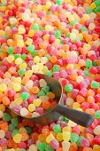 colorful sugar-coated candy with a metal spoon