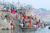 colorful hindu people bathing in the ganges river in varanasi