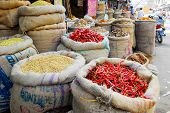 picture of indian food  - red hot chili pepper and other spices in jute gunny - JPG