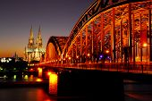View on the 'dom' cathedral and the floodlighted 'hohenzollern' railway bridge over river rhine in C
