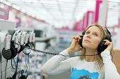 girl listening music  in store