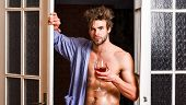 Sexy Attractive Macho Tousled Hair Coming Out Through Bedroom Door. Man With Sexy Torso Drink Wine.  poster