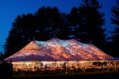Wedding tent at night - Special event tent lit up from the inside with dark blue night time sky and  poster