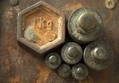 Weights For Retro Scales. Vintage Weight For A Balance Scale, Balance Weights. poster