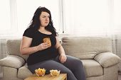 Lack Of Physical Activity, Imbalanced Nutrition, Laziness, Homebody. Lonely Fat Woman Watching Serie poster