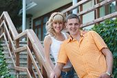 Young Couple Standing On Their Front Porch