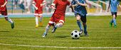 Football Soccer Players Running With Ball. Footballers Kicking Football Match. Young Soccer Players  poster