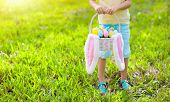 Kids With Eggs Basket On Easter Egg Hunt. poster