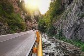 Asphalt Road Through Cliffs And Pine Forest At The Bicaz Gorge In Carpathians, Romania. The Sunrays  poster