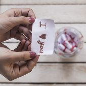 I Love You Text On Rolled Paper. Female Opening A Gift Glass Jar With Wishes poster