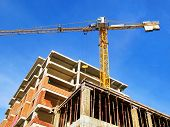 Construction Site Background. Self--erecting Crane Near The Building Under Construction poster
