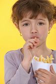 pic of frizzle  - Little girl eating French fries - JPG