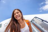 Airport travel plane arrival girl tourist arriving at destination walking out of airplane on tarmac. poster