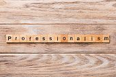 Professionalism Word Written On Wood Block. Professionalism Text On Wooden Table For Your Desing, Co poster