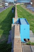 picture of katrina  - Levee wall and floodgate on the Mississippi River in New Orleans Louisiana post Hurricane Katrina - JPG