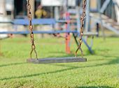 Closeup Of Swings In A Children Play Area