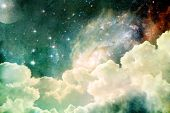 stock photo of shimmer  - A photobased cloudscape with clouds stars and moon with distant galaxies - JPG