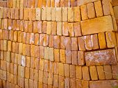foto of sag  - Stack of sagging bricks ready to topple - JPG