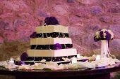 stock photo of three tier  - Large three tier purple and white wedding cake  - JPG