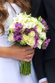 Wedding bouquet in bride's hand