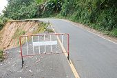 image of landslide  - Damage road from landslide on mountain in Thailand - JPG