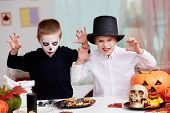 picture of antichrist  - Photo of twin eerie boys looking at camera with frightening look  - JPG
