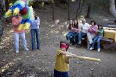 Little boy swinging at pinata