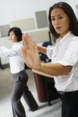 Businesswomen practicing tai chi