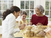 stock photo of toddlers tiaras  - Hispanic family having tea party - JPG
