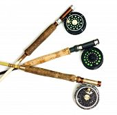 stock photo of fly rod  - Three different fly fishing rod and reels - JPG