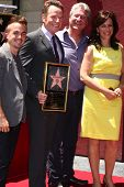 LOS ANGELES - JUL 16:  Frankie Muniz, Bryan Cranston, Producer, Jane Kaczmarek at the Hollywood Walk