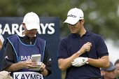 LOCH LOMOND, SCOTLAND - JUL 12 2009; Loch Lomond Scotland; Martin Kaymer (GER) and his caddy check t