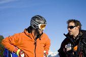 KITZBUHEL TIROL, AUSTRIA - JAN 24 2009; Kitzbuhel Tirol Austria, Bryon Friedman (USA) gets advice from team coach Chris Brigham  at the Hahnenkamm race  the men's downhill ski race part of the Audi FIS Alpine Ski  World cup.