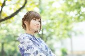 Beautiful young woman wearing japanese traditional kimono