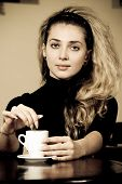 Portrait Of Beautiful Young Woman Drinking Coffee