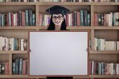 Graduate Woman With Blank Board