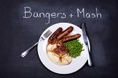 Chalkboard advertising the daily special of Bangers  and Mash